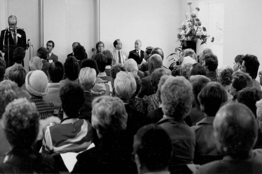 Photo of a large gathering. Official opening ceremony at Zerin Place on December 1, 1985. London Ontario.