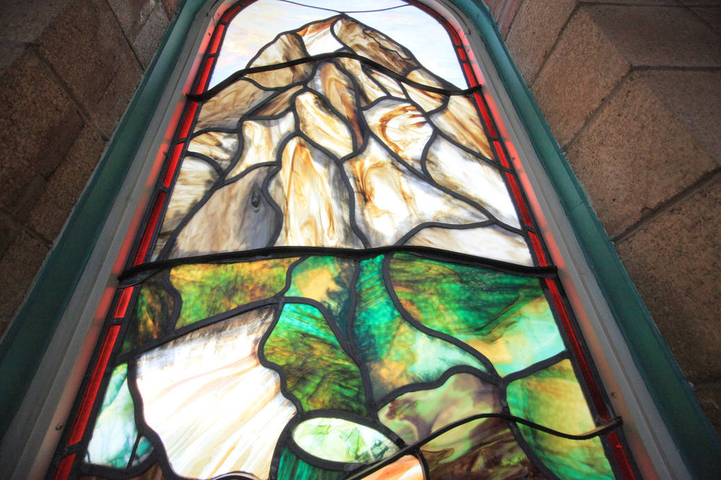 Stained glass window designed by Scotty Giffen depicting a mountain, at Zerin Place Senior Apartments in London Ontario, an affordable housing development in London Ontario by Zerin Development Corporation.