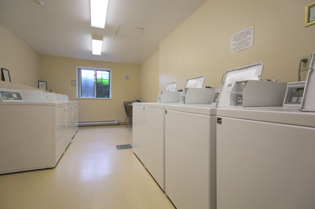 Clean, bright laundry room at Zerin Place - Affordable housing development in London Ontario by Zerin Development Corporation.