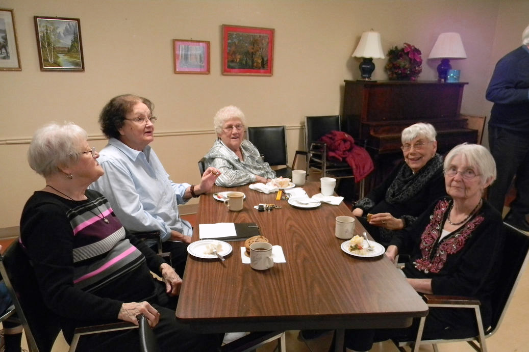 Zerin Place Seniors Apartments - Tenants enjoy some cake and coffee.