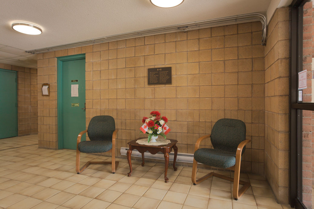 Chairs outside office in lobby inside secure door entrance. Zerin Place Seniors Apartments