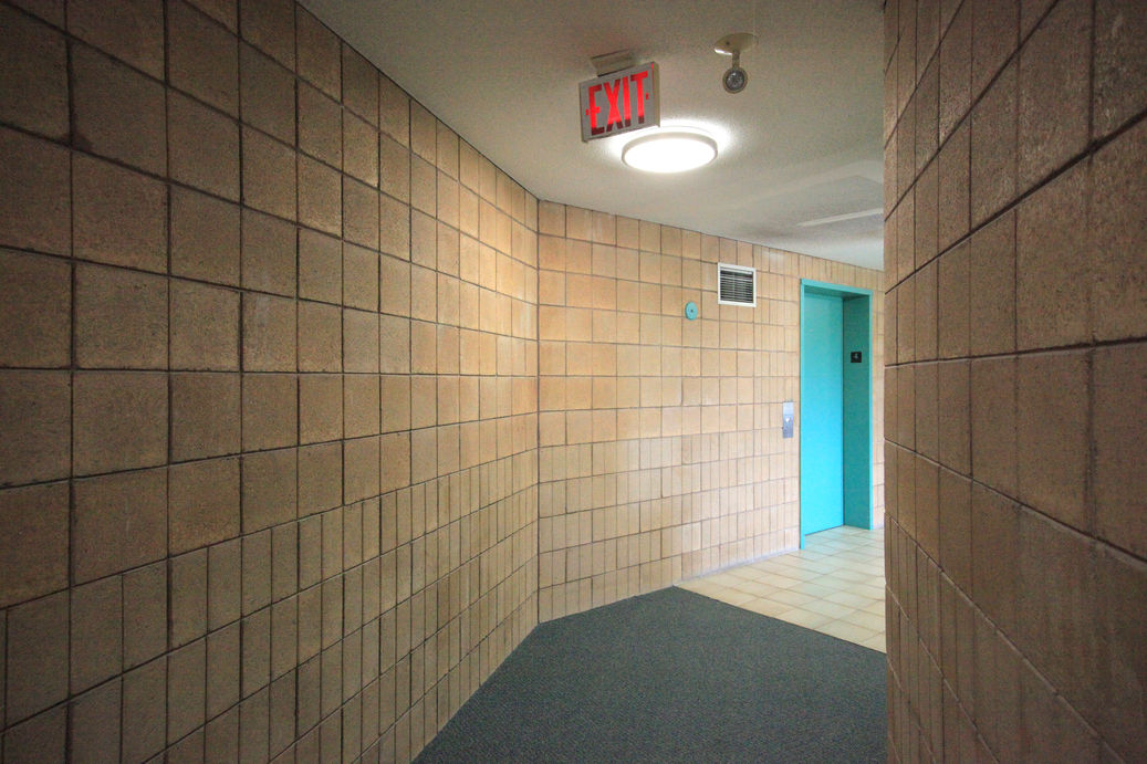 View of typical hallway leading to elevator at Zerin Place. A photo. Zerin Place is an affordable housing development and management project by Zerin Development Corporation.